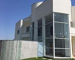 Fachada de casas com vidro fumê